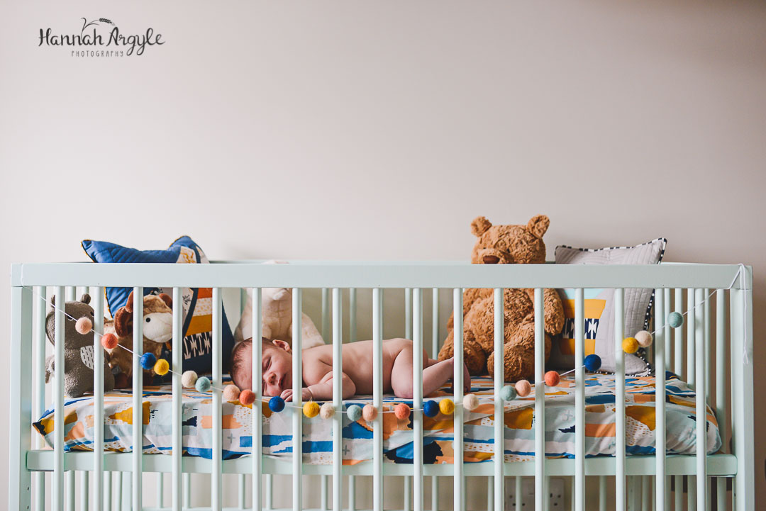 Sleeping Newborn in Cot