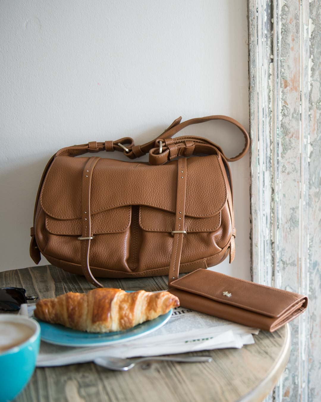Radley leather handbag and purse in cafe scene