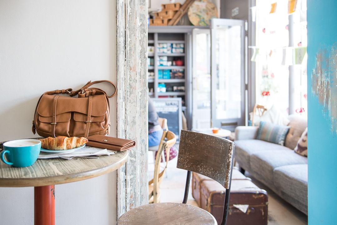 cafe scene with Radley luxury leather handbag
