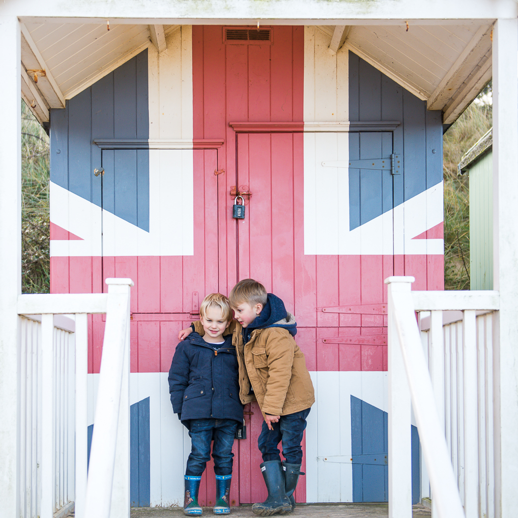 two little boys by a beach hut, family portraiture and photographing children