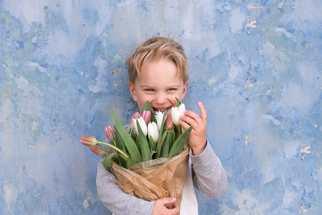 little boy holding tulips, family photography and children portraiture