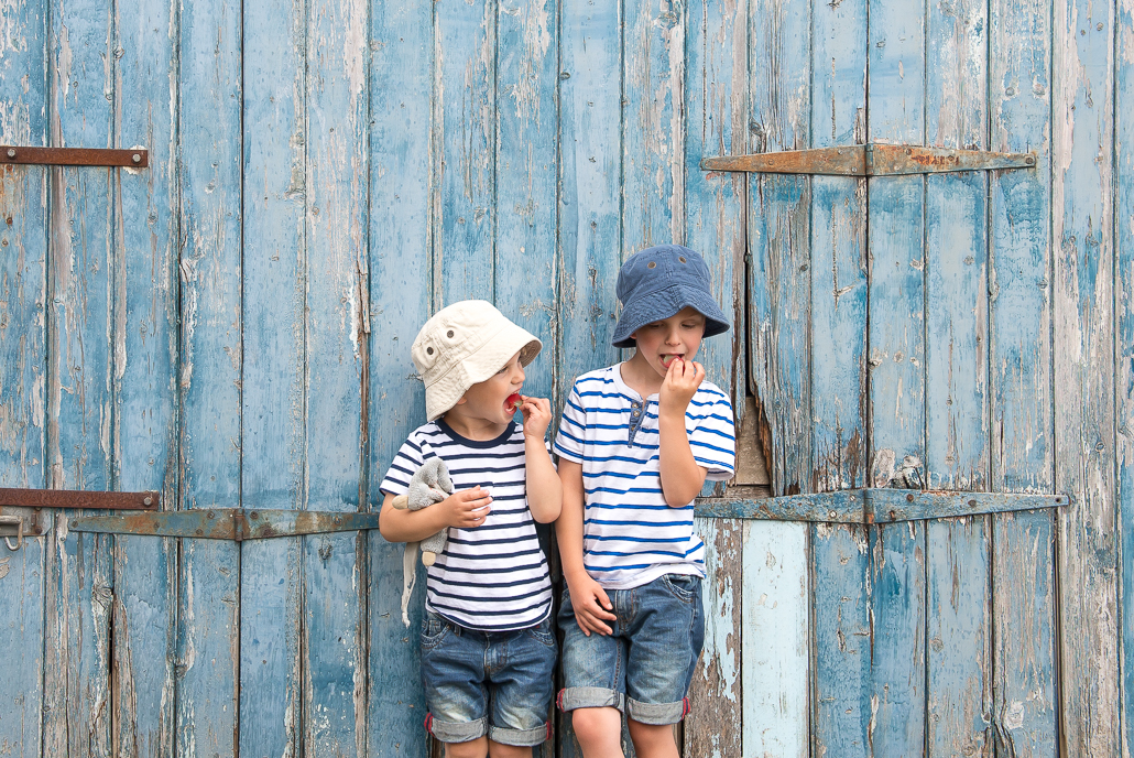 two little boys and a blue door. Family portraiture and children photography