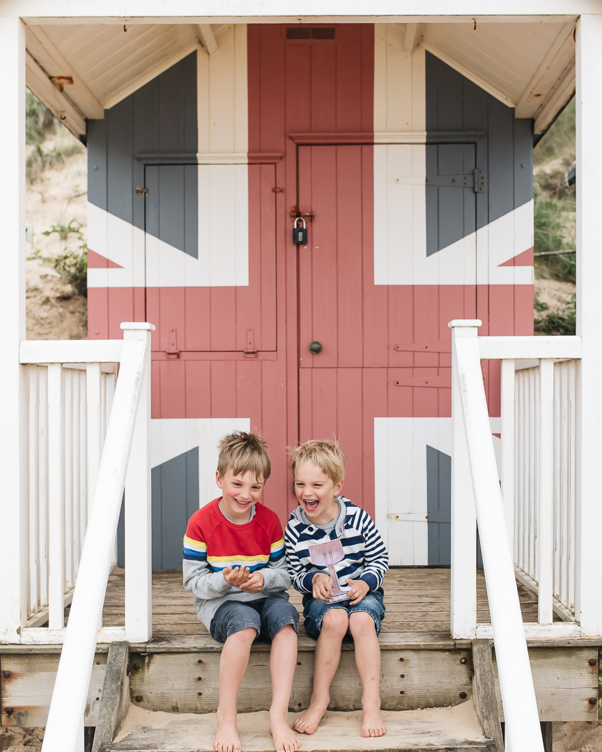 happy boys and a beach hut