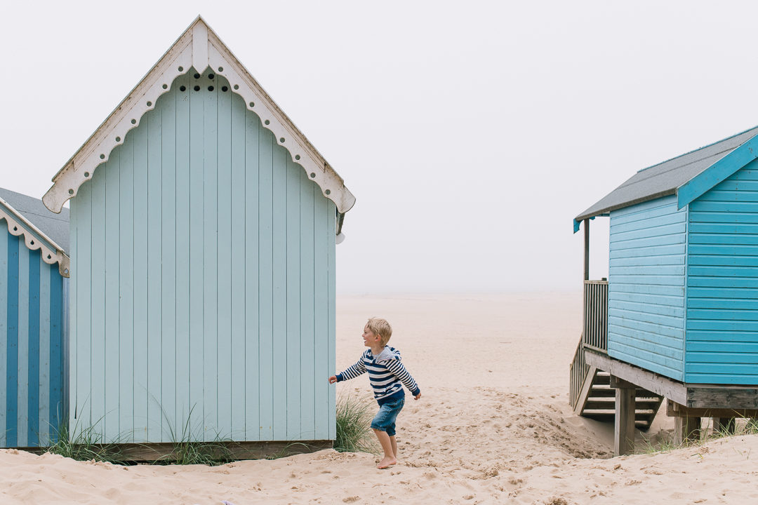 little boy and beach huts, Norfolk