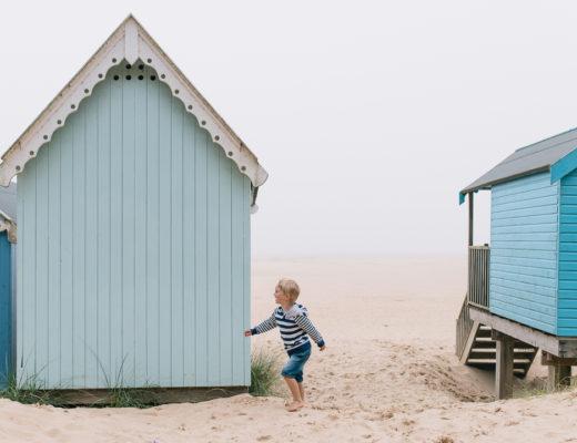 little boy and beach huts, Norfolk