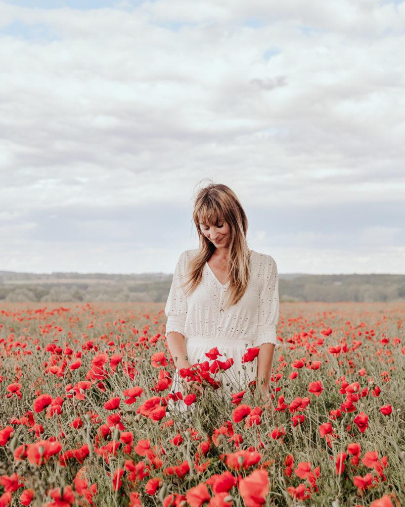 Hannah Argyle self portrait in poppy field